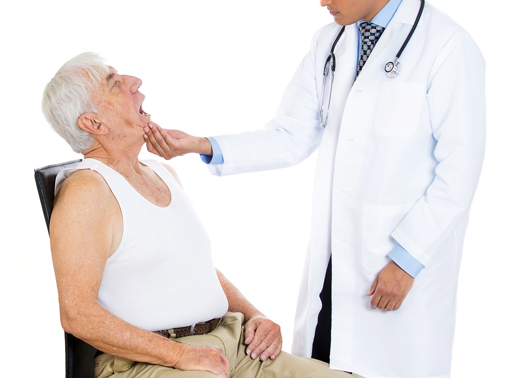 The physician is examining the patient's mouth