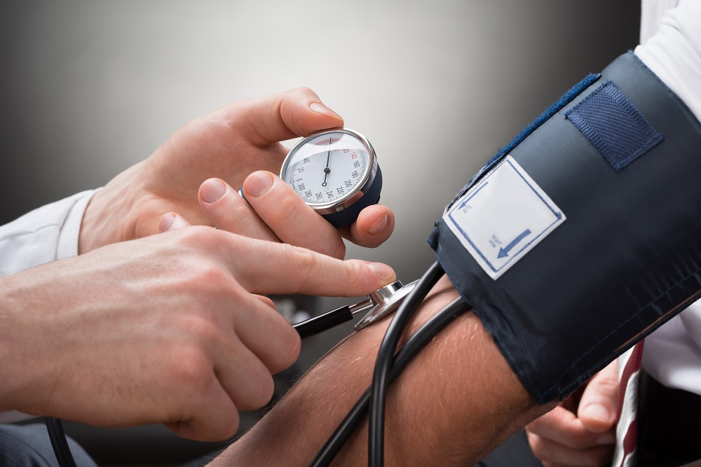 Doctor is checking blood pressure of a patient